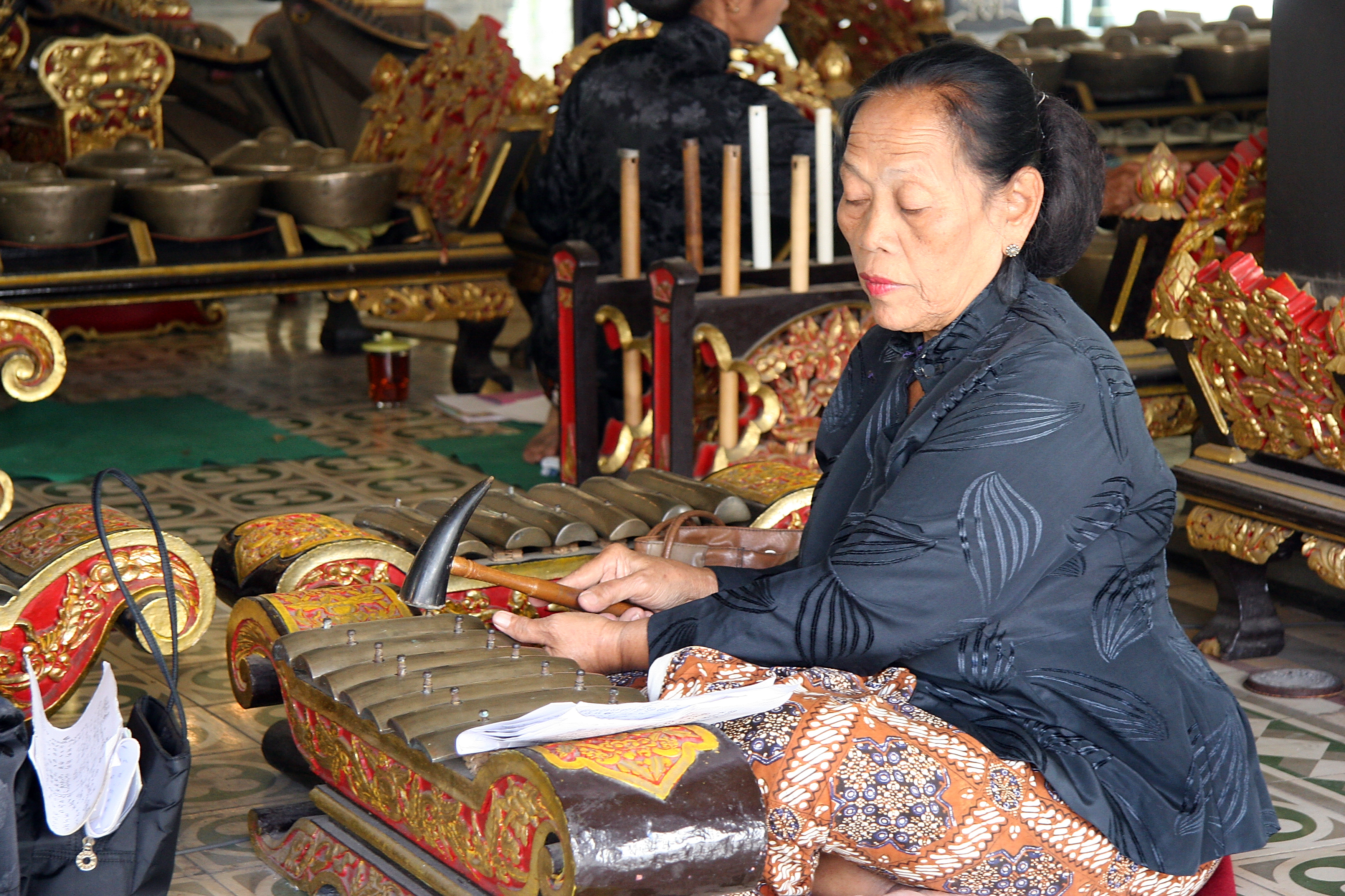 Playing the gamelan in the sultan's palace, Java Yogyakarta Indonesia 1.jpg - Indonesia Java Yogyakarta. Playing the gamelan in the sultan's palace
