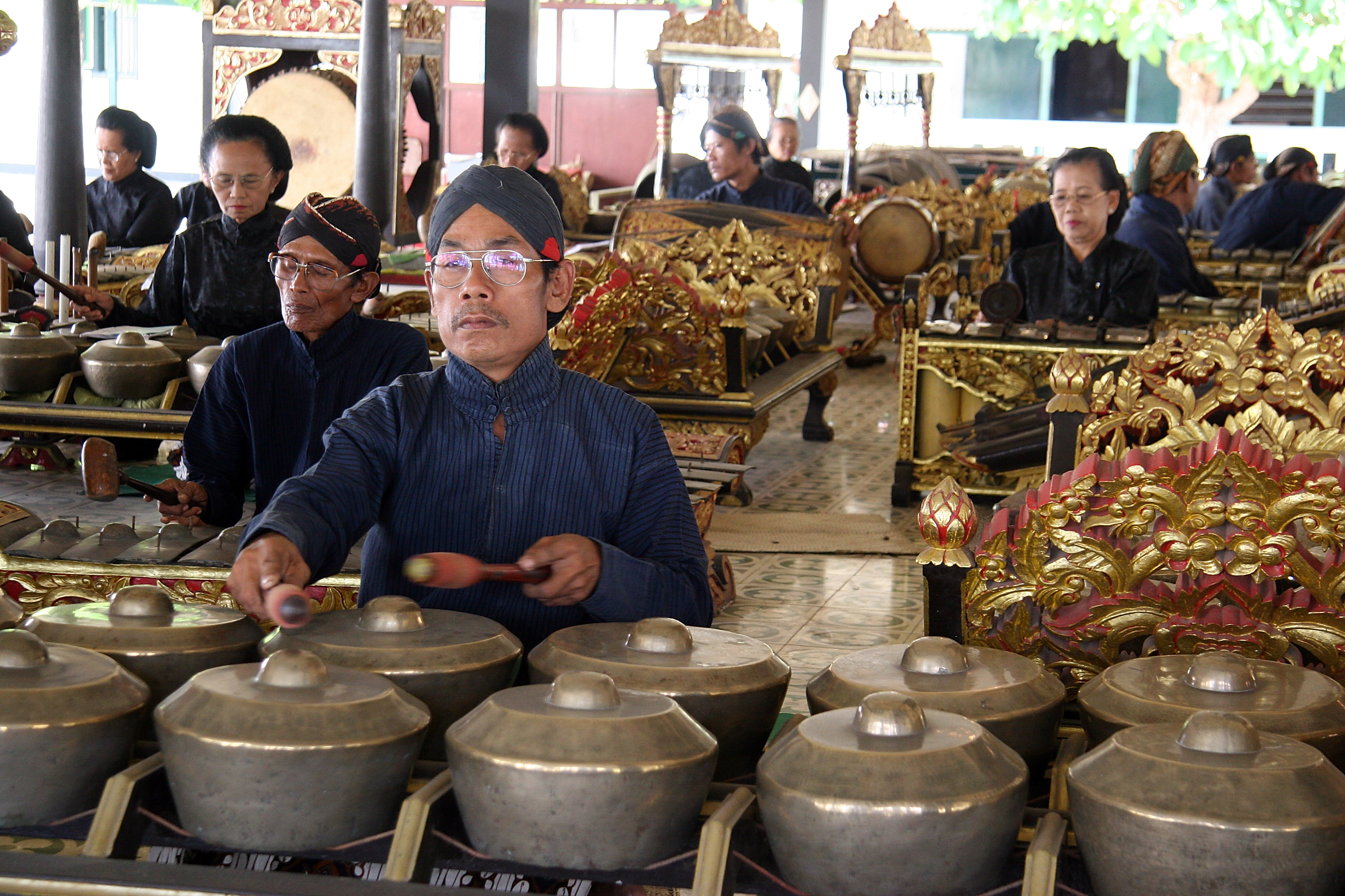 Playing the gamelan in the sultan's palace, Java Yogyakarta Indonesia.jpg - Indonesia Java Yogyakarta. Playing the gamelan in the sultan's palace